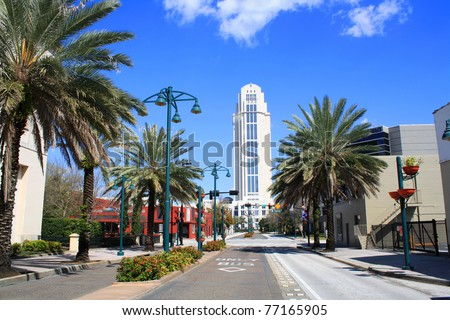 A horizontal view of downtown Orlando, Florida, looking north on Magnolia Avenue at the Orange County courthouse. - stock photo