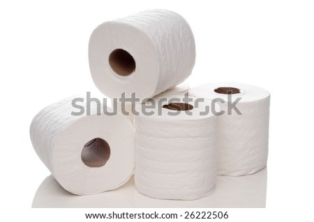 A horizontal view of quilted white toilet paper on a white reflective surface - stock photo