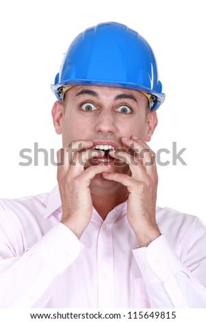 A horrified architect. - stock photo