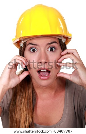 A horrified female construction worker.