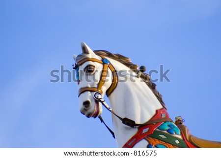 A horse ontop of building to a amusement park. - stock photo