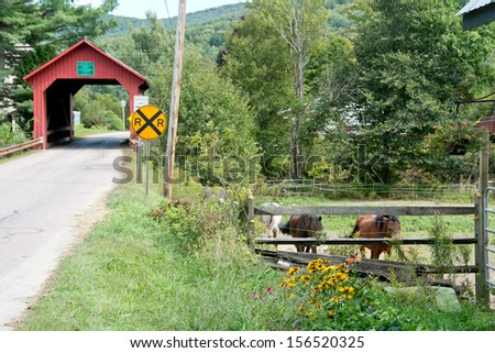 A horse pasture lies in close proximity to Lower bridge in Northfield Falls, Vermont. - stock photo