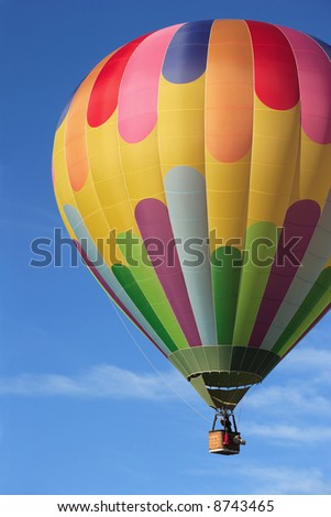 A hot air balloon high in the sky. - stock photo
