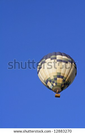 A Hot Air Balloon on an clear morning flight over Auckland City, New Zealand. - stock photo