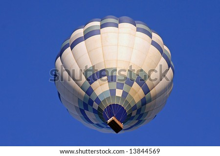 A Hot Air Balloon on an clear morning flight viewed from below. - stock photo