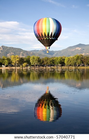 A hot air balloon rises above Prospect Lake during the Colorado Springs Balloon Classic.