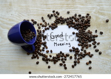 a hot Cup of coffee,coffee beans,Notepad,cinnamon,spices - stock photo