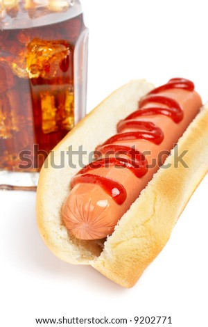 A hot dog and soda glass with shadow on white background. Shallow DOF