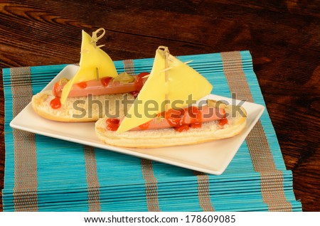 A hot dog decorated as a sailboat, creative kid snack - stock photo