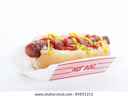 A hot dog with mustard and ketchup isolated on white - stock photo
