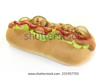 a hot dog with pickle and salad against white background - stock photo