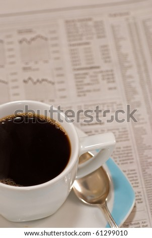 A hot early morning coffee while checking the financial news