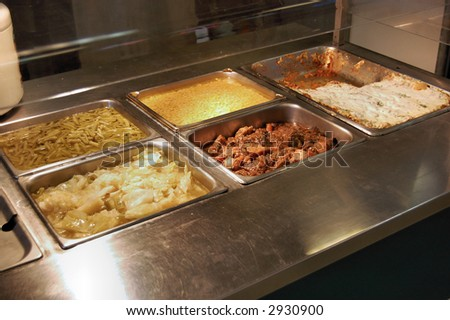 A hot serving area with varied food items. - stock photo