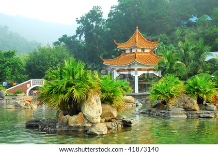 a hot spring on a river with chinese gloriette - stock photo