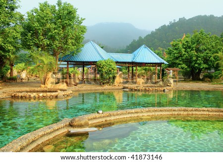 a hot spring on a river with chinese gloriette