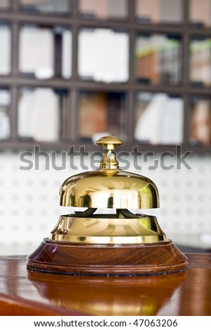 A hotel bell on a table - stock photo