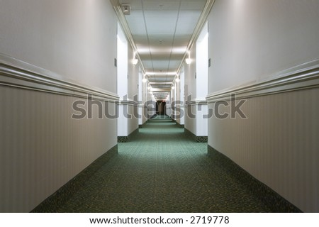 A hotel hallway. Vanishing point perspective. - stock photo
