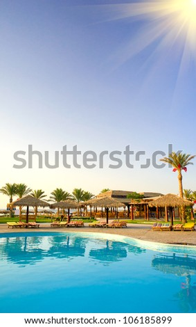 A hotel pool early morning in egyptian resort. - stock photo