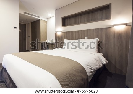 A hotel room, bedroom with twin bed, curtain, lighting front view at the night in seoul, south korea.