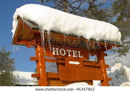 A Hotel Sign covered in Ice and Snow Bled Slovenia. - stock photo