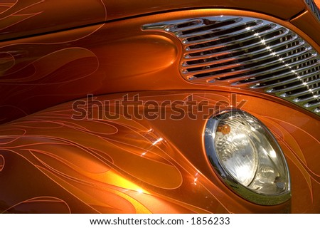 A hotrod of orange and gold. - stock photo