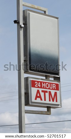 A 24 hour ATM sign with black space above for your writing. - stock photo