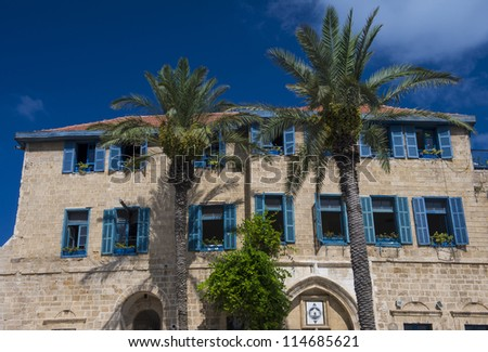 A house and palm trees in historic Jaffa , Israel - stock photo