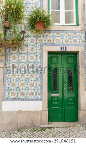 A house covered with traditional azulejo tiles, Lisbon, Portugal
