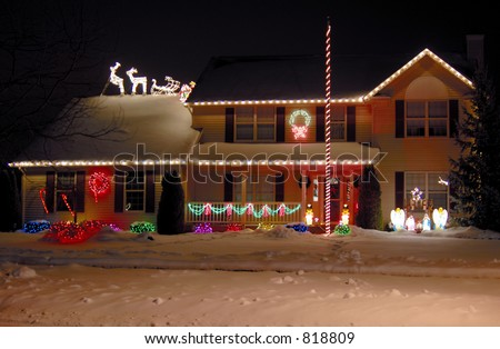 A house decorated with Christmas lights. 12MP camera.