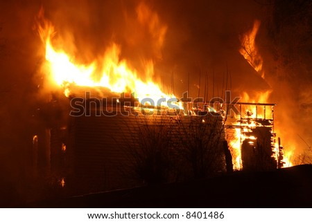 A house engulfed in fire in the southwest area of Detroit - stock photo