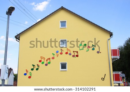 A house facade with painted colorful notes