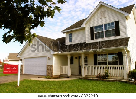 A house for sale in a suburban neighborhood - stock photo