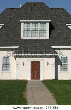 A house from a straight-on, front view. - stock photo
