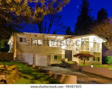 A house in suburbs at dusk ( night ) in Vancouver, Canada