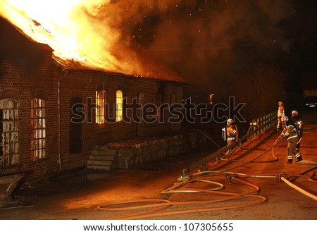 A house in Sweden burning down. - stock photo