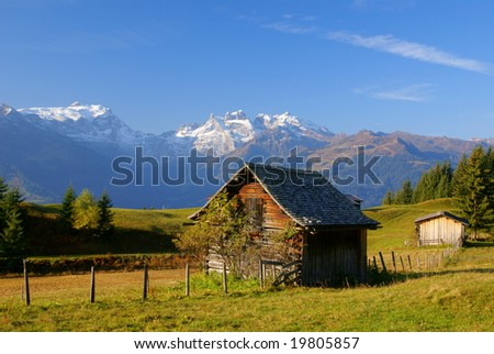 A House in the mountains with the snowy mountains