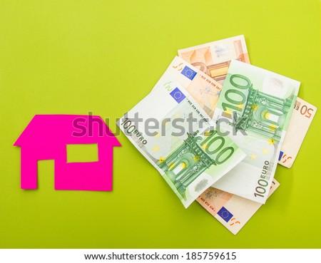 A house near a pile of euros  - stock photo