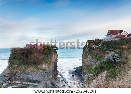 A house on a tiny island at Newquay in Cornwall - stock photo