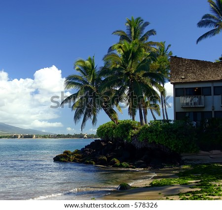 A house on the edge of the ocean in Kihei, Maui Island, Hawaii. - stock photo