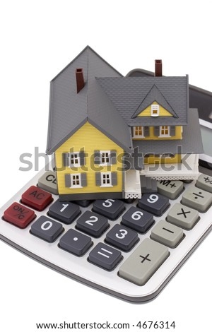 A house on top of a calculator isolated on a white background - stock photo