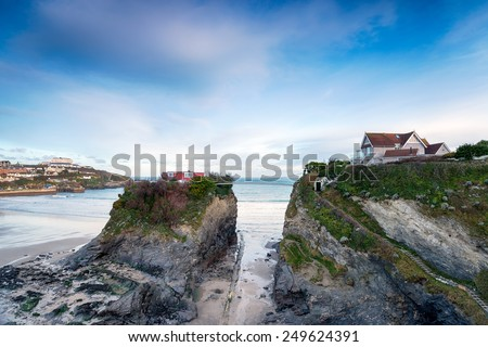 A house on Towan Island at Newquay in Cornwall, connected to the mainland by a small suspension bridge - stock photo