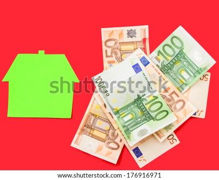 A house over a pile of euros  - stock photo