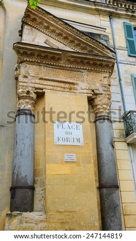 A house with Roman portico and columns at Forum square (Place du Forum) in Arles (Provence, France).  - stock photo