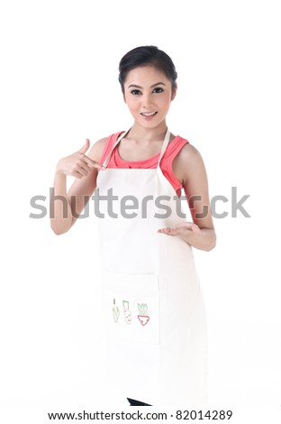 A housewife pointing to her empty hand which holding your product - stock photo