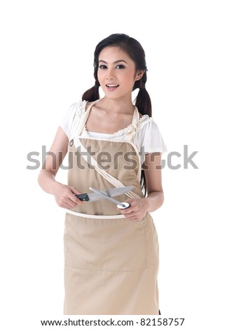 A housewife sharpening a knife with steel sharpener - stock photo