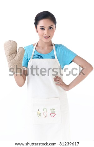 A housewife standing with kitchen protective glove - stock photo