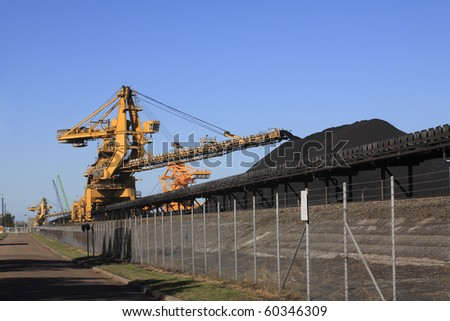 a huge coal loading conveyor belt piles coal. Kooragang Island, Newcastle, NSW, Australia - stock photo
