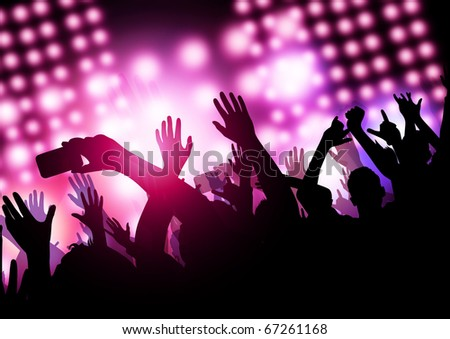 A huge excited crowd at a concert. - stock photo