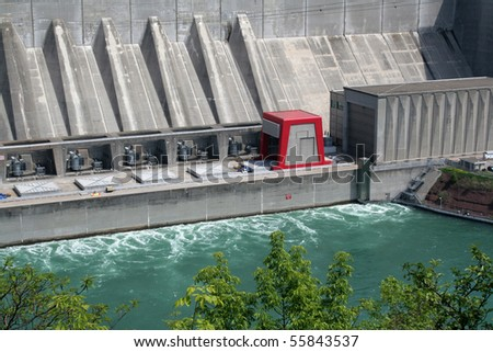 A huge hydro electric power plant on a river. - stock photo