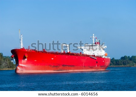 A huge red oil tanker - stock photo